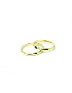 Alianzas de oro amarillo con diamante azul